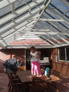 Pergola-completed-with-kids-playing