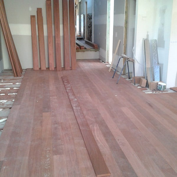 Floorboards getting installed in home